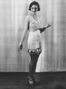 A 1920s girdle. Girdles of the 1920s usually extended from waistline to hipline, came in white or peach-tone elastic, and were worn over ste...