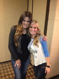 "Khloe Kardashian with Ali Dee from CMT's ""Texas Women"" at a Dallas Mavericks game."