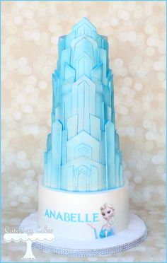 Frozen castle themed cake with Elsa and snow.  www.facebook.com/i.love.cuteology.cakes