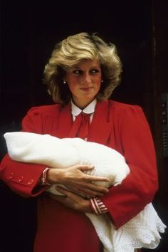 September 16, 1984: Princess Diana leaves St Mary's Hospital with baby Prince Harry, the day after giving birth. Wearing a red dress. Prince Charles brought little Prince William to the Hospital to greet them, dressed to match his mother Diana Princess of Wales, in red shorts and a red and white shirt.