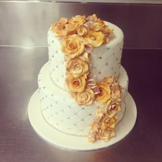 2 tier wedding cake with flower trail and quilting on both tiers