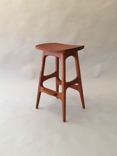 We are very happy with the lines of the stool and comfort of the seat. Fine handmade wooden furniture by Joseph van Benten Furnituremakers in Brookline, Massachusetts.