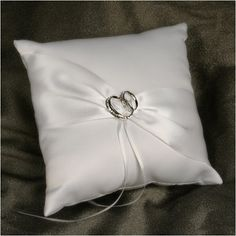 WeddingDepot.com ~ Ring Bearer Pillow - With This Ring - White ~ This elegant ring pillow is covered in soft matte satin. The front of the pillow is accented with a diagonal ribbon gathered by a pair of wedding rings with crystals.