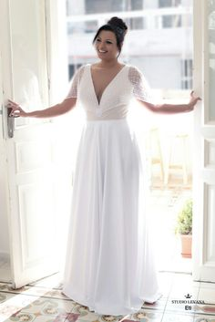 Plus size wedding dress with unique sleeves and a deep cleavage is so flattering! Eti. Studio Levana