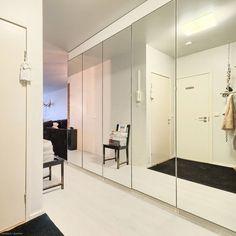 Walk-in closet behind the mirror doors.