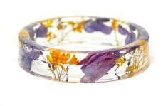 This dried flower resin bracelet is pretty cool. ~Nate Real Flower Jewelry  orange jewelry  purple jewelry