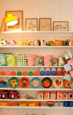 Kitsch collection neatly displayed with a lamp nearby to light it.