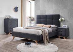 I really like the look of this contemporary bed. The height of the headboard is probably one of my favorite aspects. I wouldn't mind getting something like this for the guest bedroom my wife and I are putting together in our home.