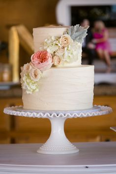 Elegant + simple wedding cake idea - two tiered buttercream-frosted wedding cake with pastel flowers {Tracy Autem & Lightly Photography}