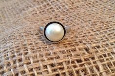 This stylish and chic ring was handcrafted using sterling silver and a 10mm, freshwater, AAA grade button pearl. This ring is one of my absolute