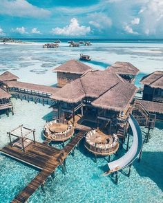 Overwater Villa with a slide at the Gili Lankanfushi Maldives. Vacation Places, Honeymoon Destinations, Dream Vacations, Vacation Spots, Places To Travel, Places To Visit, Honeymoon Ideas, Romantic Vacations, Vacation Packages
