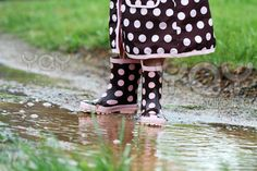232. Walking through puddles in rain boots.