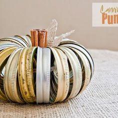 Autumn pumpkin decor made from canning jar lids.