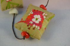 Unique handmade embroidered cushion necklace par Creatine1 sur Etsy Embroidered Cushions, Green Necklace, Japanese, Christmas Ornaments, Holiday Decor, Fabric, Pink, Handmade, Etsy