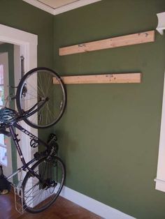 DIY bike rack. I'm doing this for our 4 bikes this weekend! Already have the hooks.