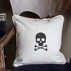 Offer a little comfort as you frighten guests and family members alike with our Crossbones Pillow. It a truly chic way to decorate for Halloween,    but don bring him out only at a party! He comfy enough for use all season long. Plumped with polyester filling, this canvas pillow is just    right in the living room perhaps adorning the bed of your resident teenager.            White canvas throw pillow printed with a black skull and crossbones                Soft poly fill and cord trim a...
