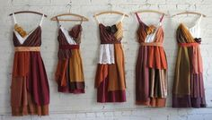 autumnal bridesmaids dresses in browns, mustards, oranges, and burgundies with lace accents.  Custom, eco-friendly, and one-of-a-kind.