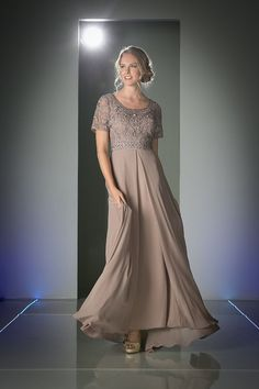 A simply elegant floor length chiffon dress. Features lace covered sleeves and silk cord trim overlay. Simple beading adds a hint of sparkle and the square neck