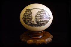 Scrimshaw tall ship cannon battle on ostrich egg by artist Rachael Calkins