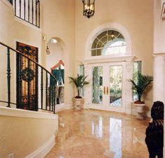 Grand entryway, marble floor, arched window, French doors, spiral staircase...could it get any better?