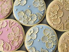"6 Orange Vanilla Spice Cookies iced in muted colors with ""embroidered"" royal Icing flowers painted with edible pearl dust in gold. Each cookie measures about 3-1/2"" in diameter."