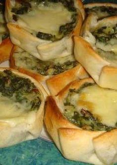 Canastitas de acelga, salsa blanca y queso