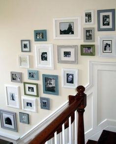Multiple colored frames on a stair gallery wall