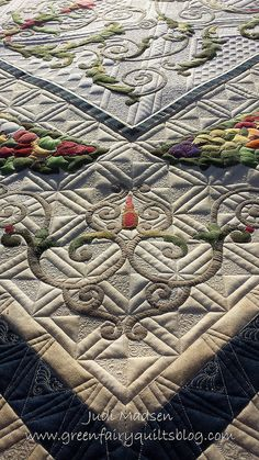 It doesn't get better than Green Fairy Quilts - Judi Madsen is an amazing quilter - Check out her blog on this quilt: Flourish on the Vine and Around the World Bloghop!