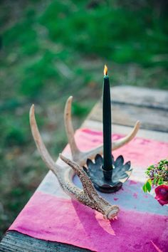 Black candle and antlers | Paula Bartosiewicz Photography | see more on: http://burnettsboards.com/2014/05/bohemian-gemstone-shoot-diy-elements/