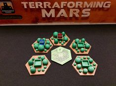 Play Terraforming Mars with these upgraded greenery tiles. They are made from durable PLA plastic and are nearly the same size as the cardboard tiles. The underside of the tile has a decorative hex for no reason other than it sets this tile apart from the other tiles on the market.  When you