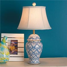 Handpainted ceramic is adorable in fun colors with a Moroccan tile pattern. Pick from Powder Blue or Apple Green or Poppy Pink on a cream background painted with artistic precision on a classic urn shape. Topped with a beige linen bell shade. This table lamp has a smaller size for dressers, bedside tables and more.