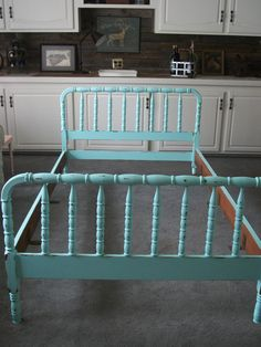 """we already have this bed, in this exact color, stored away for Maggie's future """"big girl"""" room.  I'm thinking we might go ahead and put it in the room with her crib when we move into our new house.  It'll serve as a place to sit/play/read/sleep as we transition out of the crib."""