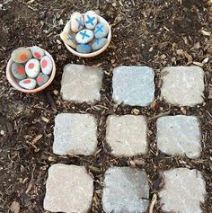 Outdoor tic tac toe using stone tiles and rocks. I would make a small garden for the kids and have this in it. Cute decor when the kids aren't playing with it. --Meggie