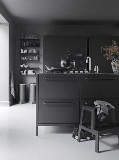The waste bins, shelves, glasses, and ceramics are by Vipp. Est Living @estemag #estliving #estdesigndirectory