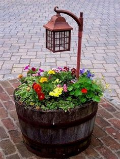 20 Fabulous DIY Garden Art Projects for This Spring 20 Fabulous Art DIY Garden Projects for This Spring - barrel planter with lamp post Outdoor Planters, Outdoor Gardens, Diy Planters, Outdoor Garden Decor, Log Planter, Fence Planters, Vintage Garden Decor, Indoor Outdoor, Lawn And Garden