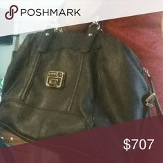 GUESS black leather purse MAKE OFFERS PRICE FIRM ORRR FREEEE (W/ purchase of $55+)  Braided handle, silver hardware, Everything Must go. I negotiate on bundle offers!!!!  (ALL MY ITEMS ARE CROSS-POSTED! If you love it, Don't sleep on it!!! Every item with double digits is UP FOR NEGOTIATION. MAKE ME OFFERS, please and thanks!)  PRICE FIRM ORRR FREEEE (W/ purchase of $55+) Guess Bags