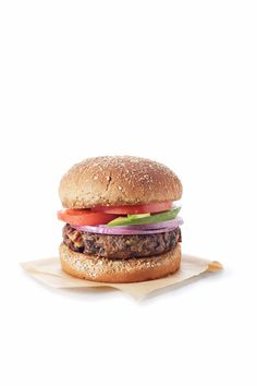 20-Minute Black Bean Burgers | Making a vegetarian burger shouldn't have to mean spending hours roasting vegetables, cooking beans, and forming patties. This quick and tasty recipe can have dinner on the table in less than 30 minutes. Try using half of a spare whole-grain hamburger bun in place of the bread slice. These burgers also work with any other canned bean variety, just mix and match the spices based on bean chosen. Za'atar and oregano would pair well with garbanzo beans, while a…