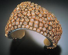 Todd Reed's hollow cuff of floating diamonds, winner of the 2002 Jewelry Arts Awards