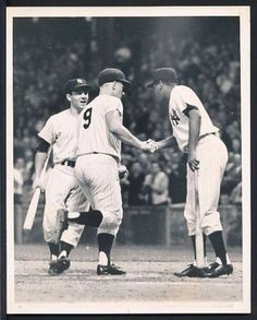 Roger Maris crossing home plate when he tied Ruth at 60.  Bobby Richardson & Elston Howard waiting.