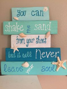 Hand painted reclaimed wood beach sign. This handmade wooden beach sign reads You can shake the sand from your shoes but it will never leave your soul. Each pallet board is hand painted in different shades of blue/aqua , white and light blue to create an ombre-type effect. Adorned with real seashells (shells and starfish may vary depending on what I have on hand). Makes a great addition to your beach home decor or give as a gift for your favorite beach lover! This listing is made to order…