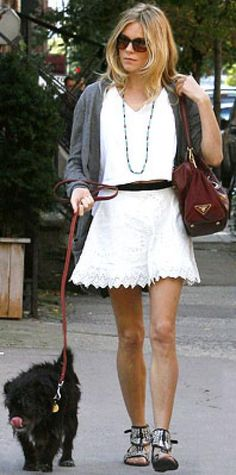 Look of the Day › October 10, 2009 WHAT SHE WORE Toting her favorite Prada bag, Miller wore a cropped T-shirt with a lace skirt, woven sandals and oversize cardigan WHERE Out and about in New York City