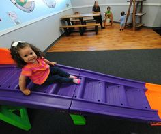 The Around the Globe Kid's Center opened on Broadway in May. The indoor playground offers a slide, a padded train, brightly colored tumbling mats, a play kitchen and more. #DTLA #LA #LosAngeles #DowntownLA #kids #children #fun #playground #indoorplayground