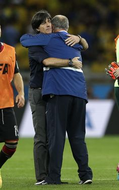 Brazil's coach Luiz Felipe Scolari, right, embraces Germany's head coach Joachim Loew after the World Cup semifinal soccer match between Brazil and Germany at the Mineirao Stadium in Belo Horizonte, Brazil, Tuesday, July 8, 2014. Germany won the match 7-1