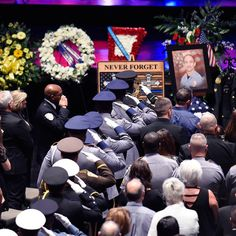 Police salute the casket during funeral services for #BatonRouge Police officer Matthew Gerald