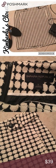 "🛍BANANA REPUBLIC🛍 Skirt Gorgeous black and ivory patterned Banana Republic skirt.  Fully lined.  Back vent.  Button tab accents at waist and back pocket..  Front pockets.  Back zip closure.  Hand wash.  Measures 14"" across the top of the waist and and approx. 18.5"" long.  Only worn a couple of times - excellent condition. Banana Republic Skirts"