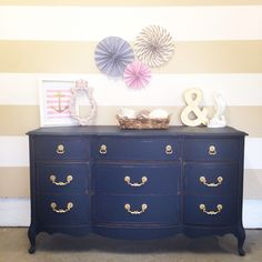 Custom mix of Annie Sloan chalkpaint to get this navy blue color. Napoleonic blue graphite and emporerors silk. The gold peeking through from distressing is a real show stopper.