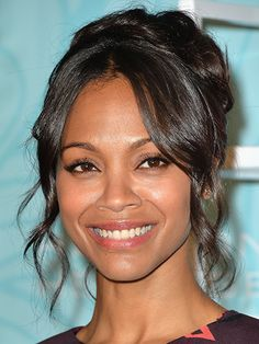 If you have dark skin, like Zoë Saldana's, black cat-eye liner can define your eyes without looking made up. Using a gel formula (Tom Ford Noir Absolute for Eyesworks well), trace a line across the top lashes, winging it out slightly at the outer corners. Brush on a couple of coats of mascara (give the outer lashes one extra layer) and apply a raspberry lip color, likeStila Lip