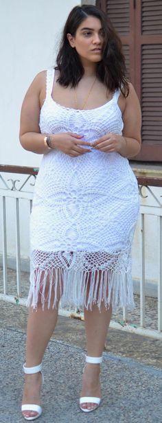 Nadia Aboulhosn in white fringe crochet dress by Emma Östergren