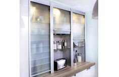 Why half hide your clutter behind glazed or reflective unit fronts? In a small space, this can work well because the reflection will add to ...