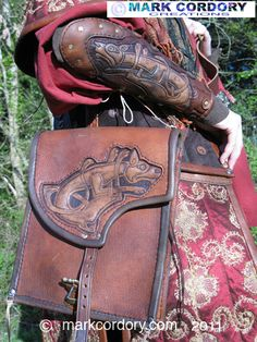 Tooled leather bag and vambrace made for LARP by Mark Cordory Creations Viking Garb, Viking Reenactment, Leather Armor, Leather Tooling, Tooled Leather, Leather Backpack, Leather Bag, Hero Costumes, Larp